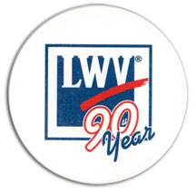white coaster with League anniversary logo
